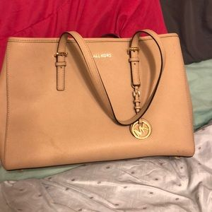 Micheal kors purse used 3 tines